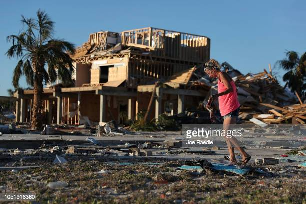 Roxy Atchley looks for items to salvage from where her friend's home once stood before it was knocked down when Hurricane Michael passed through the...