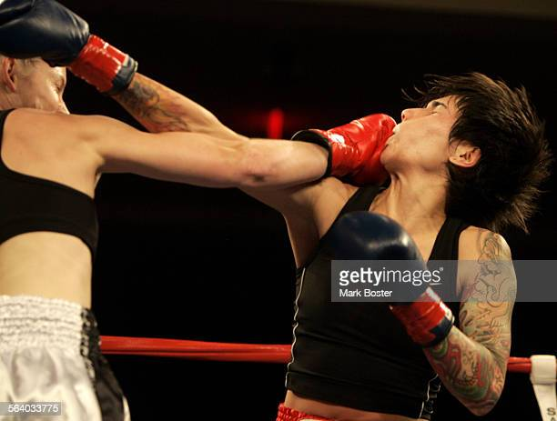–Roxy Balboa Richardson takes a punch to the chin in her Full Rules Muay Thai bout against opponent Christina Martin at the San Manuel Indian Bingo...