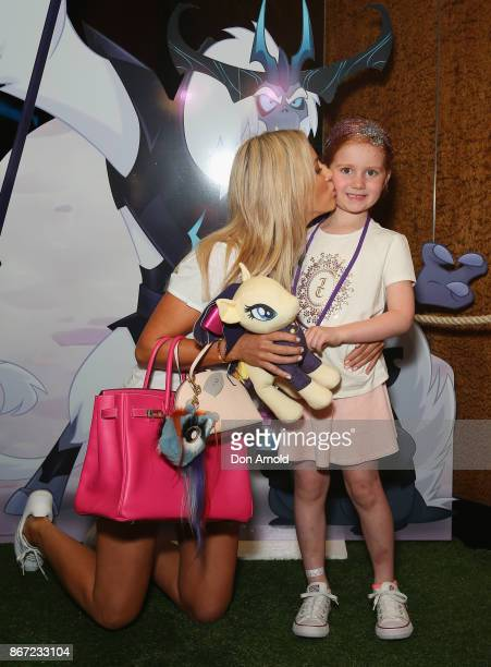 Roxy Jacenko kisses daughter Pixie Curtis ahead of the My Little Pony The Movie Sydney Premiere on October 28 2017 in Sydney Australia
