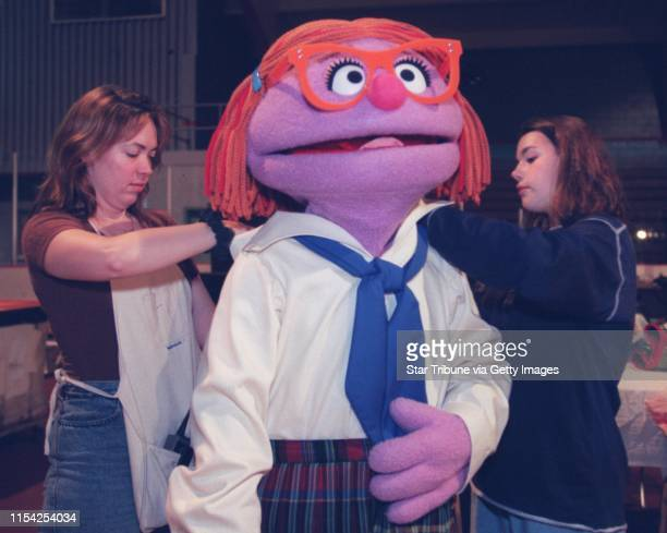 Roxy Marie center is adjusted by head of wardrobe Meredith Eaton left and production assistant Kalyn waters right before a rehearsal of Sesame Street...