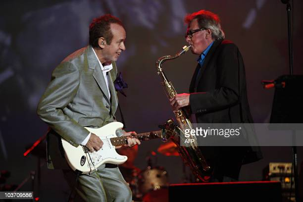 Roxy music guitarist Phil Manzanera and saxophonist Andy Mackay perform on stage August 29 during the Rock en Seine festival at the SaintCloud park a...