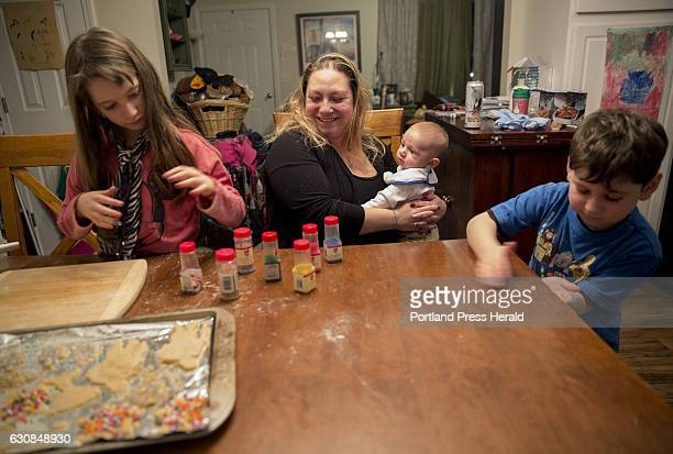 Roxy Rovin at left Everett Rovin at right and their Mom Amy Starr bake and decorate Hanukkah cookies at their home in Gorham The family is also...
