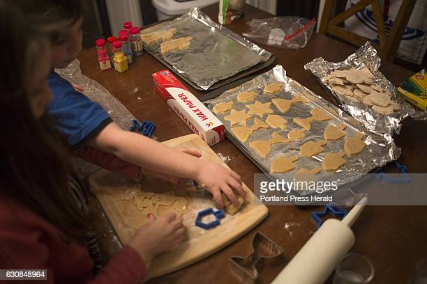 Roxy Rovin Everett Rovin and their Mom Amy Starr bake and decorate Hanukkah cookies at their home in Gorham The family is also helping Starr's...
