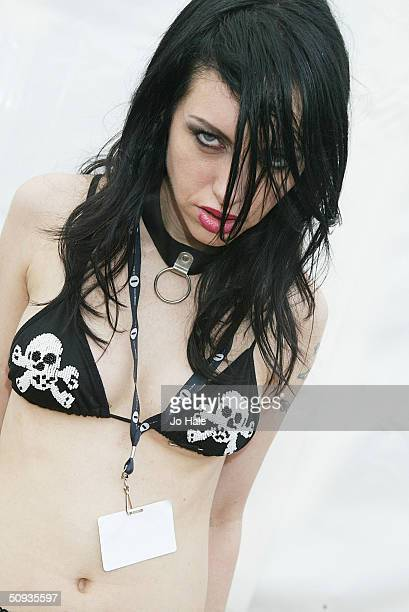 Roxy Saint poses backstage at day two of the Download Festival at Donington Park on June 6 2004 in Leicestershire England The rock festival features...