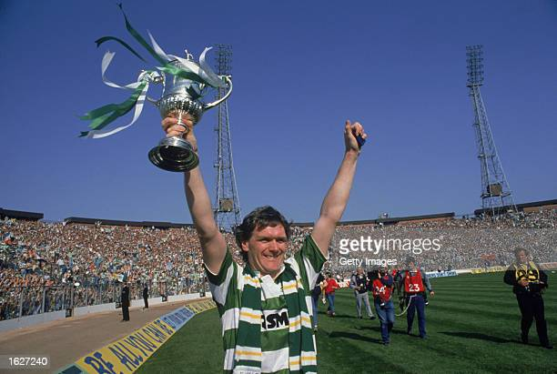 Roy Aitken of Celtic holds aloft the trophy after winning the Scottish Cup Final match against Dundee United at Hampden Park in Glasgow, Scotland....
