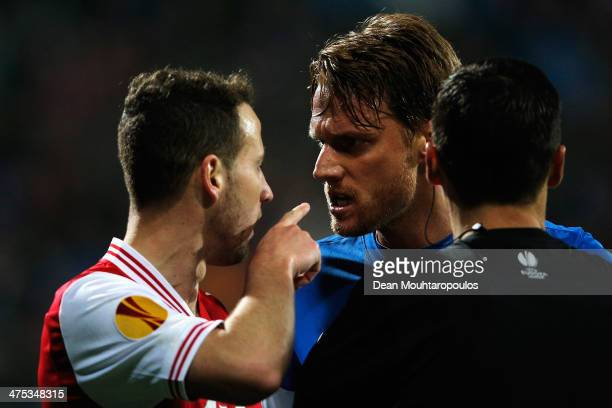 Roy Beerens of AZ points his finger in the face of Radoslav Kovac of Slovan Liberec after he reacts as referee, Serhiy Boiko looks on during the UEFA...