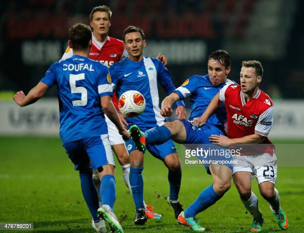 Roy Beerens of AZ Vladimir Coufal and Josef Sural of Slovan Liberec battle for the ball during the UEFA Europa League Round of 32 match between AZ...