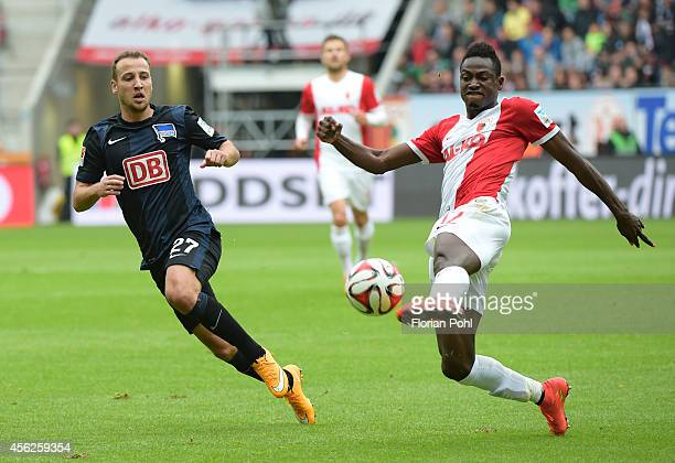 Roy Beerens of Hertha BSC and Abdul Rahman Baba of FC Augsburg during the game between FC Augsburg and Hertha BSC on September 28 2014 in Augsburg...