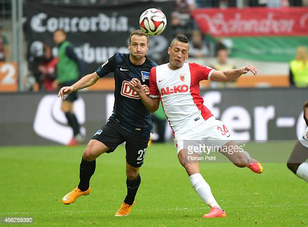 Roy Beerens of Hertha BSC and Nikola Djurdjic of FC Augsburg during the game between FC Augsburg and Hertha BSC on September 28 2014 in Augsburg...