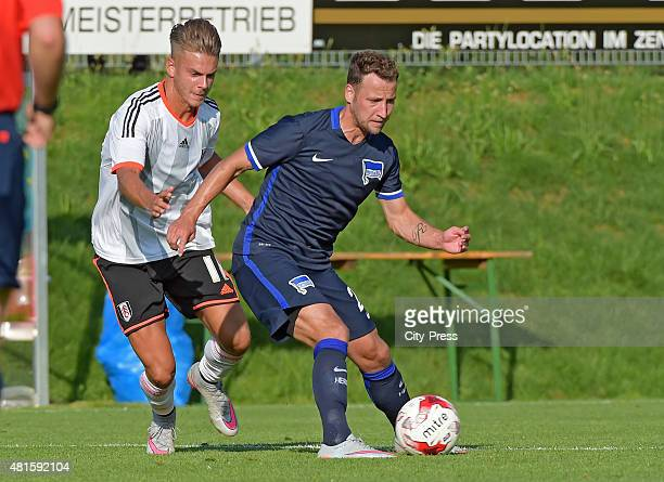 Roy Beerens of Hertha BSC handles the ball against Adam Taggart of FC Fulham during the game between Hertha BSC and FC Fulham on july 22 2015 in...