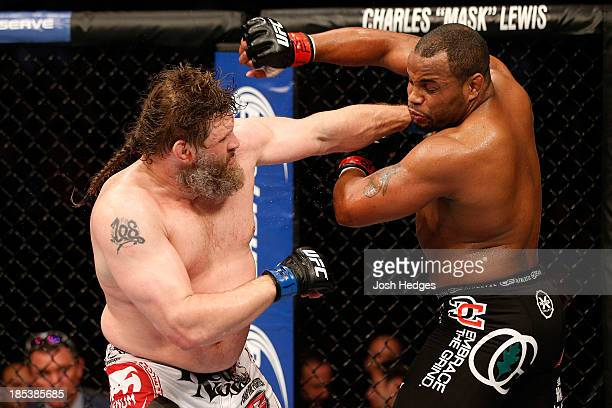 Roy 'Big Country' Nelson punches Daniel Cormier in their UFC heavyweight bout at the Toyota Center on October 19 2013 in Houston Texas Daniel Cormier...