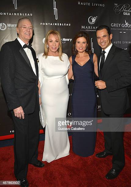 Roy Black Lea Black Adriana Henao and Helio Castroneves attend Blacks' Annual Gala at Fontainebleau Miami Beach on October 25 2014 in Miami Beach...