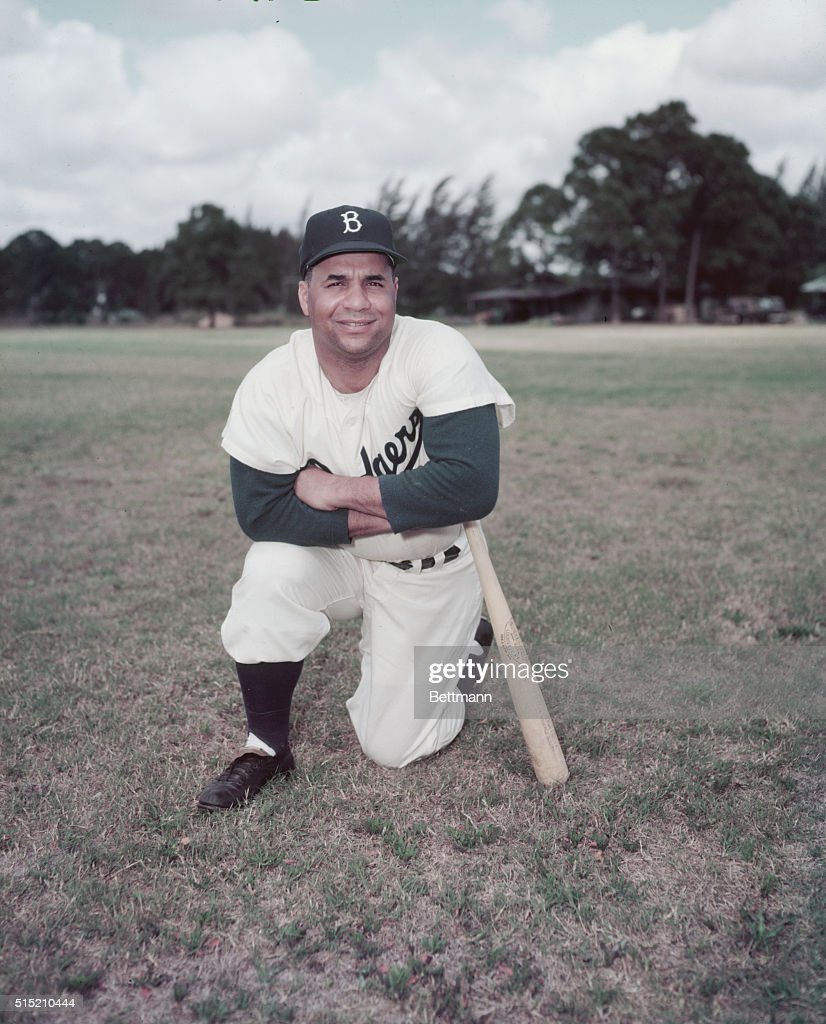 2/24/1953- Roy Campanella, baseball player, Full length kneeling with bat.