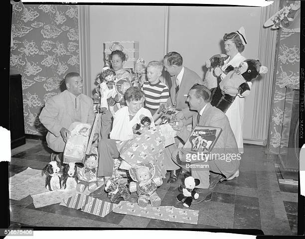 Roy Campanella Gil Hodges and Jack Uchitel prepare toys for the annual Yule party at House of St Giles the Cripple