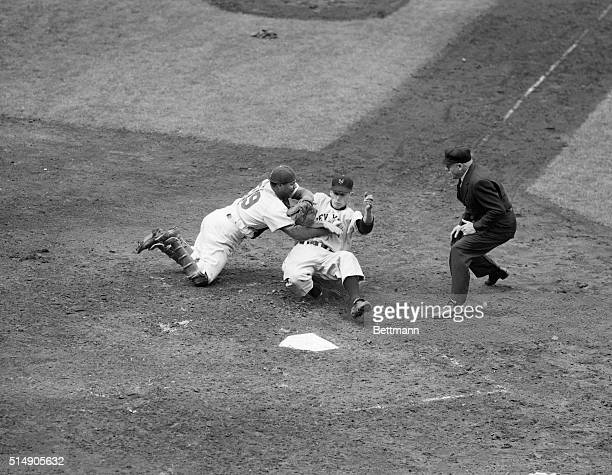 Roy Campanella tags out New York Giants rookie first baseman Jack Harshman as he tries to slide into home during a Giants-Dodgers game at Ebbets...