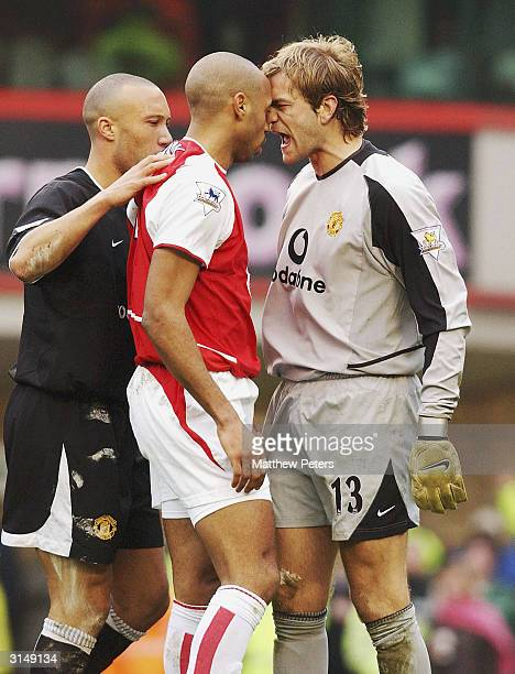 Roy Carroll of Manchester United shouts accusingly at Thierry Henry of Arsenal after the Frenchman went down in the penalty box during the FA...