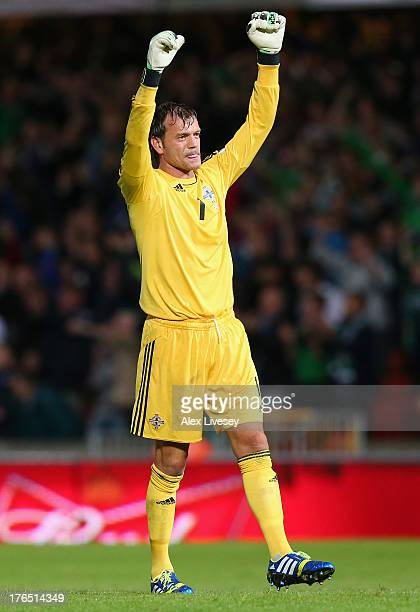 Roy Carroll of Northern Ireland celebrates after victory over Russia in the FIFA 2014 World Cup Group F Qualifier match between Northern Ireland and...