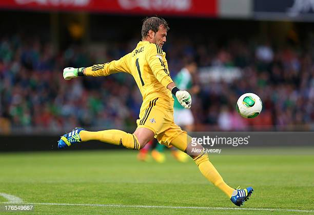 Roy Carroll of Northern Ireland clears the ball during the FIFA 2014 World Cup Group F Qualifier match between Northern Ireland and Russia at Windsor...
