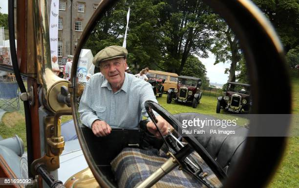 Roy Charlton chairman of the vintage Austin register reflected in a wing mirror of a 1911 Austin car at the Dalriada Festival at Glenarm Castle Co...