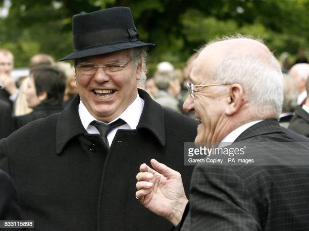 Roy 'Chubby' Brown and Jim Bowen arrive for the funeral of Bernard Manning at Blackley Crematorium Manchester