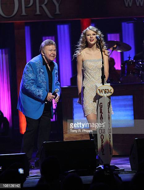 Roy Clark and Taylor Swift perform during the Grand Ole Opry 85th birthday bash at the Grand Ole Opry House on October 9 2010 in Nashville Tennessee
