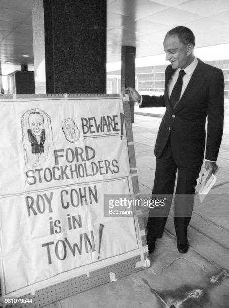 Roy Cohn, a New York attorney involved in a Ford Motor Co., stockholders suit, stops to admire a sign outside the Ford Auditorium where the Ford...