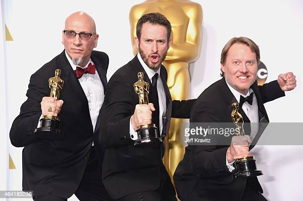 Roy Conli Chris Williams and Don Hall with the award for best animated feature film for 'Big Hero 6' pose in the press room during the 87th Annual...