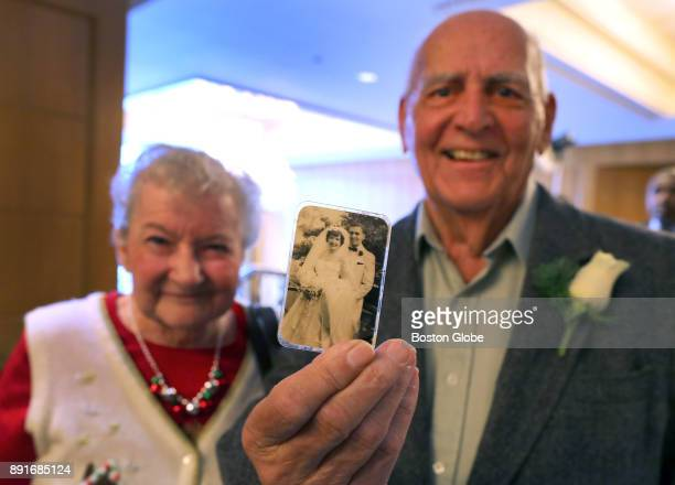 Roy Crawford shows the wedding photo taken in 1954 of him and his wife Mary to whom he has been married for 63 years at the annual Boston Elderly...