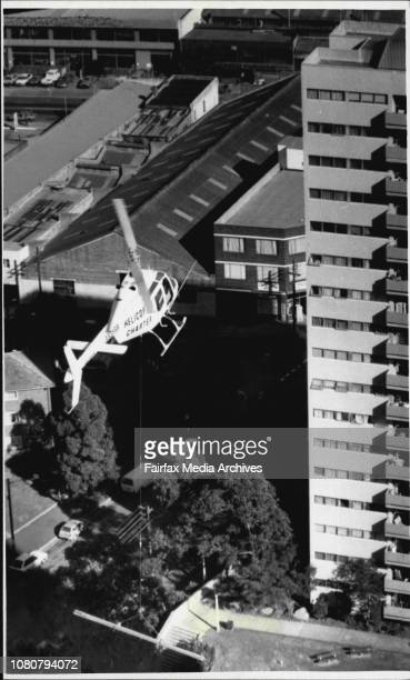 Roy Cullen, inspector Dept of Industrial Relations, PR Dept of Housing Commission NSW, Helicopter Charter Pty. Ltd. Mascot.The two 29 floor tall...