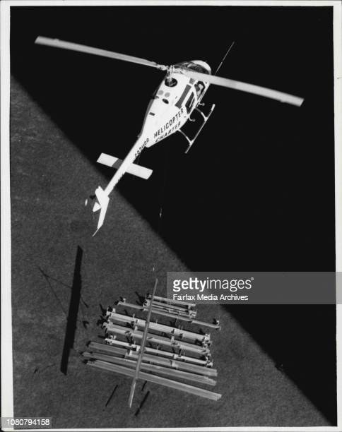 Roy Cullen inspector Dept of Industrial Relations PR Dept of Housing Commission NSW Helicopter Charter Pty Ltd MascotPackets of roofing on groundThe...