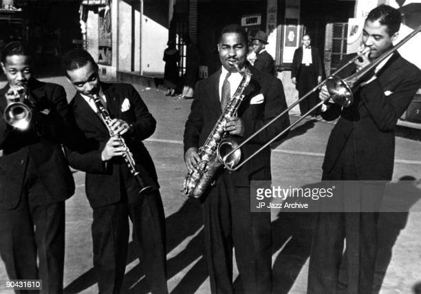 Roy Eldridge Russell Procope Chu Berry and Dicky Wells pose together in front of the Savoy Ballroom in Harlem New York in 1935