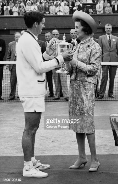 Roy Emerson of Australia being presented with the Gentlemen's Singles Championship Trophy from Princess Marina the Duchess of Kent after defeating...