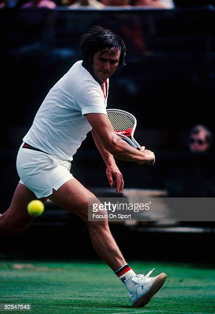 Roy Emerson returns a serve with a backhand