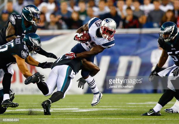 Roy Finch of the New England Patriots is tackled by Malcolm Jenkins of the Philadelphia Eagles on a kickoff return in the first half during the...