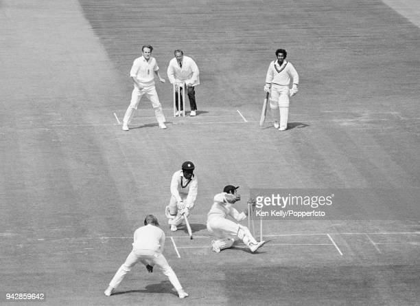 Roy Fredericks of West Indies manages to ground his bat in time to avoid being stumped by England wicketkeeper Alan Knott during the 2nd Test match...