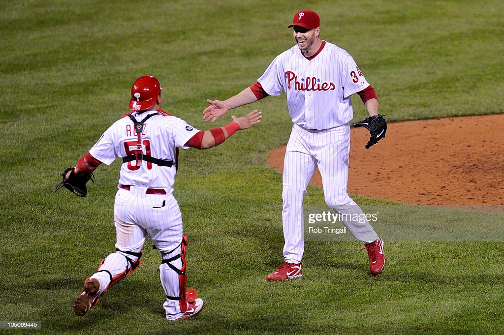 Roy Halladay #34 of the Philadelphia Phillies celebrates with Carlos Ruiz #51 after throwing a no hitter against the Cincinnati Reds on October 6, 2010 during Game 1 of the NLDS at Citizens Bank Park in Philadelphia, Pennsylvania. The Phillies defeated the Reds 4-0.