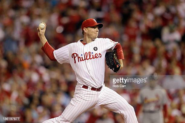 Roy Halladay of the Philadelphia Phillies throws a pitch against the St Louis Cardinals during Game Five of the National League Divisional Series at...