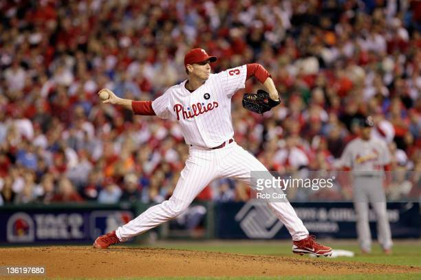 Roy Halladay of the Philadelphia Phillies throws a pitch against the St. Louis Cardinals during Game Five of the National League Divisional Series at...