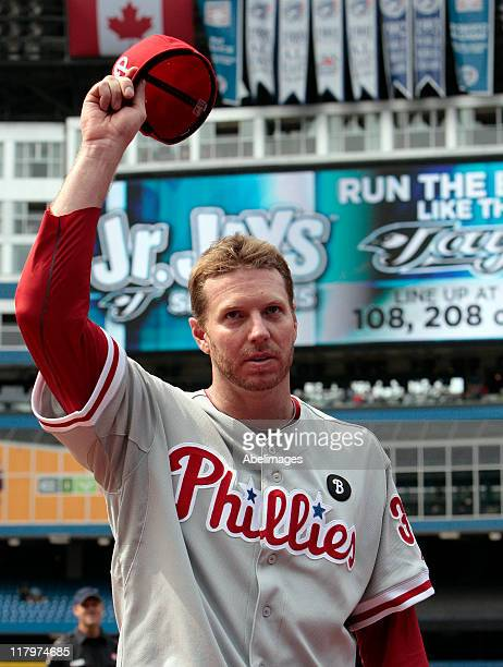 Roy Halladay of the Philadelphia Phillies waves after a complete game win against the Toronto Blue Jays during MLB action at The Rogers Centre July 2...