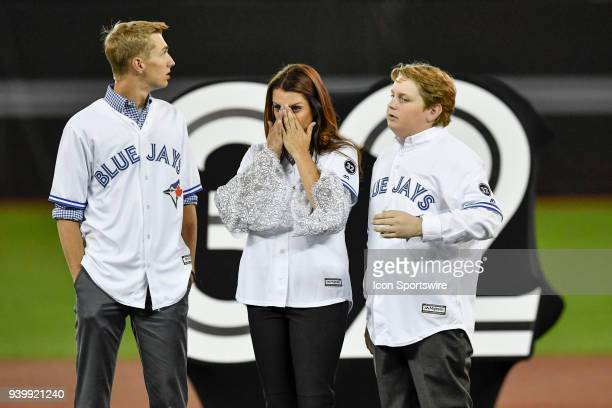 Roy Halladay's family son Braden wife Brandy and other son Ryan take in the emotion during a ceremony honoring the late pitcher by retiring his No 32...