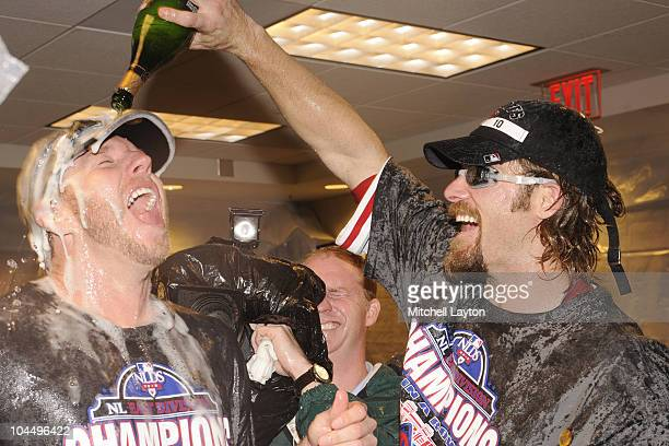 Roy Halliday and Jayson Werth of the Philadelphia Phillies celebrate clinching the National League East Title after a baseball game against the...