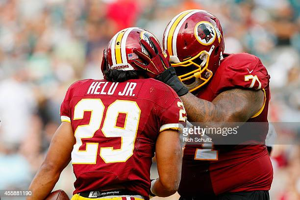 Roy HeluJr #29 of the Washington Redskins celebrates his fourth quarter touchdown with teammate Trent Williams against the Philadelphia Eagles at...