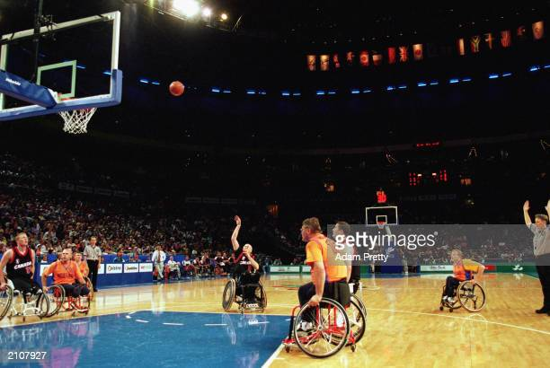 Roy Henderson of Canada shoots during the Men's Wheelchair Basektball Gold Medal Final against Team Netherlands during the Sydney 2000 Paralympic...