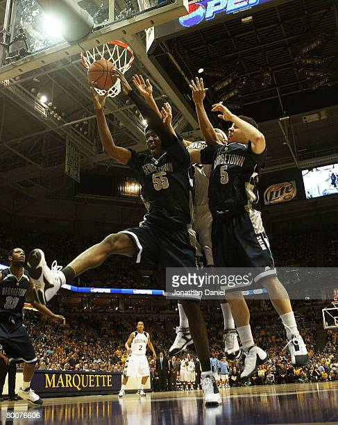 Roy Hibbert and Jeremiah Rivers of the Georgetown Hoyas box out Lazar Hayward of the Marquette Golden Eagles to grab a rebound on March 1 2008 at the...