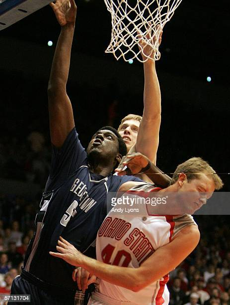 Roy Hibbert of the Georgetown Hoyas battles for the ball with Matt Sylvester of the Ohio State Buckeyes during the Second Round of the 2006 NCAA...
