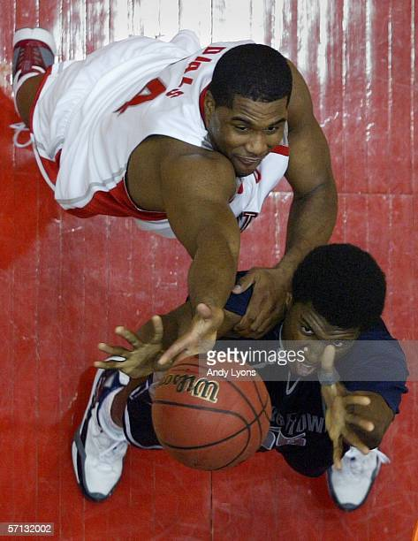 Roy Hibbert of the Georgetown Hoyas battles for the ball with Terence Dials of the Ohio State Buckeyes during the Second Round of the 2006 NCAA Men's...