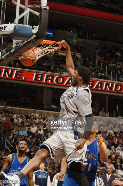 Roy Hibbert of the Georgetown Hoyas makes a jam during a basketball game against the Seton Hall Pirates at Verizon Center on February 2, 2008 in...