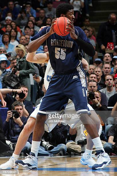 Roy Hibbert of the Georgetown Hoyas posts up against the University of North Carolina Tar Heels during the NCAA Men's East Regional Final at the...