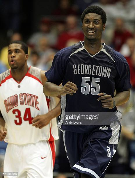 Roy Hibbert of the Georgetown Hoyas smiles while Terence Dials of the Ohio State Buckeyes follows during the second half of the game in the Second...