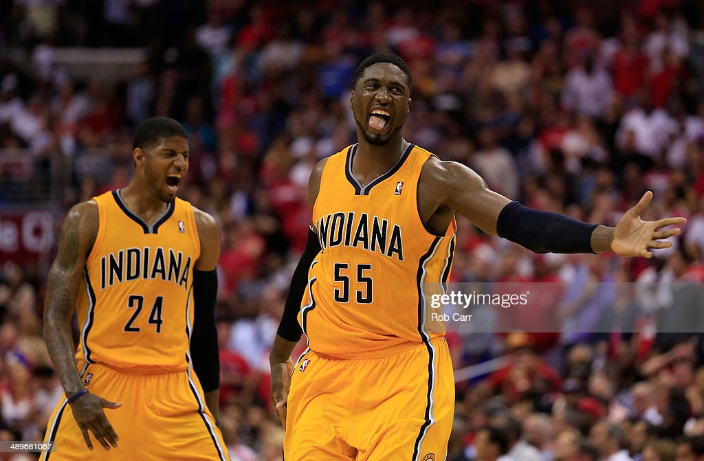 Roy Hibbert #55 of the Indiana Pacers and teammate Paul George #24 celebrate after Hibbert scored a basket late in the fourth quarter of the Pacers 95-92 win over the Washington Wizards during Game Four of the Eastern Conference Semifinals during the 2014 NBA Playoffs at Verizon Center on May 11, 2014 in Washington, DC.